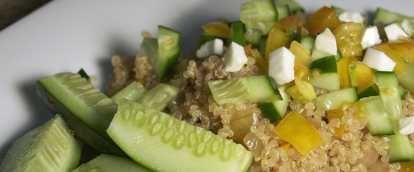 Summertime quinoa with tomatoes, cucumbers and mozzarella