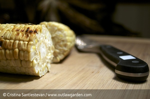 cut your corn in half for easily kernel removal